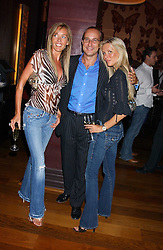 Left to right, GRACE RICCI, PAUL McKENNA and CHARMIAN TAYLOR at a party to celebrate the publication of 'Everything I Know About Men I Learnt From My Dog' by Clare Staples held at Fifty, St.James's, London on 7th September 2005.<br />