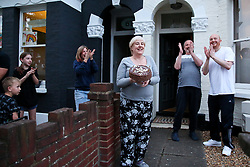 © Licensed to London News Pictures. 16/04/2020. London, UK. Members of the public in Haringey, north London take part in 'Clap For Our Carers' by applauding NHS staff, carers and key workers. The campaign has been encouraging people across the UK to take part in a round of applause from their windows, doors and front gardens to show their appreciation for the efforts of the NHS staff, carers and key workers during the COVID-19 pandemic. Photo credit: Dinendra Haria/LNP