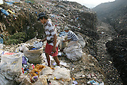 Mountains of Manila's trash are picked through every day at the Payatas dumpsite outside Manila, Philippines. (Supporting image from the project Hungry Planet: What the World Eats.)
