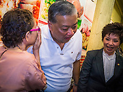 16 JANUARY 2013 - BANGKOK, THAILAND:  SUKHUMBHAND PARIBATRA, candidate for Governor of Bangkok, talks to voters in a small restaurant in Bangkok. The Oxford educated Sukhumbhand is a member of the Thai royal family (he is a great grandson of the late Thai King Chulalongkorn). He is a member of the Thai Democrat party and was first elected Governor of Bangkok in 2009. He is running for reelection this year. Sukhumbhand faces six challengers in the March 3 election. His toughest opponent is expected to be Police General Pongsapat Pongcharoen, who is running under the banner of the Pheu Thai Party, which controls the Prime Minister's office and Parliament.    PHOTO BY JACK KURTZ