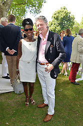 BARONESS BANJAMIN and her husband KEITH TAYLOR at the Flannels for Heroes Cricket tournament in association with Dockers in aid of the charities Walking With The Wounded, On Course Foundation and Combat Stress held at Burton Court, London on 20th June 2014.