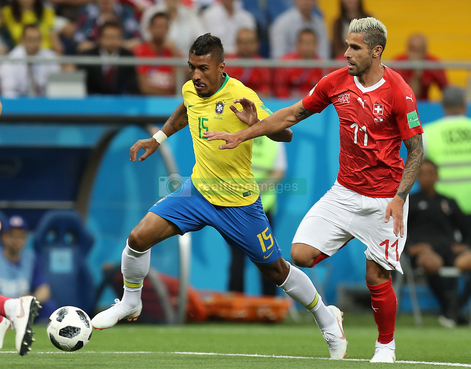ROSTOV-ON-DON, June 17, 2018  Paulinho (L) of Brazil vies with Valon Behrami of Switzerland during a group E match between Brazil and Switzerland at the 2018 FIFA World Cup in Rostov-on-Don, Russia, June 17, 2018. (Credit Image: © Lu Jinbo/Xinhua via ZUMA Wire)