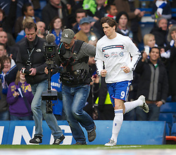 LONDON, ENGLAND - Sunday, February 6, 2011: Chelsea's new signing Fernando Torres, chased by a television cameraman, runs out to warm-up before the Premiership match against Liverpool at Stamford Bridge. (Photo by David Rawcliffe/Propaganda)