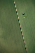 Crop dusting. Seeding rice fields in Richvale, California, USA. Laser leveled fields.