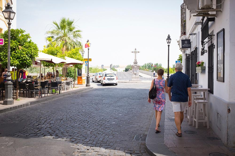 A couple walk on the Plaza Cruz del Rastro, Cordoba, Andalusia, Spain