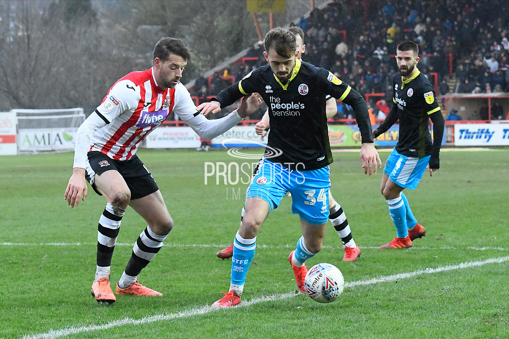 Jack Powell (34) of Crawley Town battles for possession with Aaron Martin (5) of Exeter City during the EFL Sky Bet League 2 match between Exeter City and Crawley Town at St James' Park, Exeter, England on 29 February 2020.