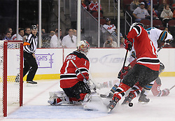 Oct 21; Newark, NJ, USA; New Jersey Devils goalie Johan Hedberg (1) makes a pad save during the first period of their game against the San Jose Sharks at the Prudential Center.