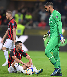 AC Milan's Mateo Musacchio(L) and GianLuigi Donnarumma (R) disappointed  during Serie A soccer match between FC Inter and AC Milan in Milan, Italy, oct 21, 2018. FC Inter won 1-0. (Credit Image: © Alberto Lingria/Xinhua via ZUMA Wire)