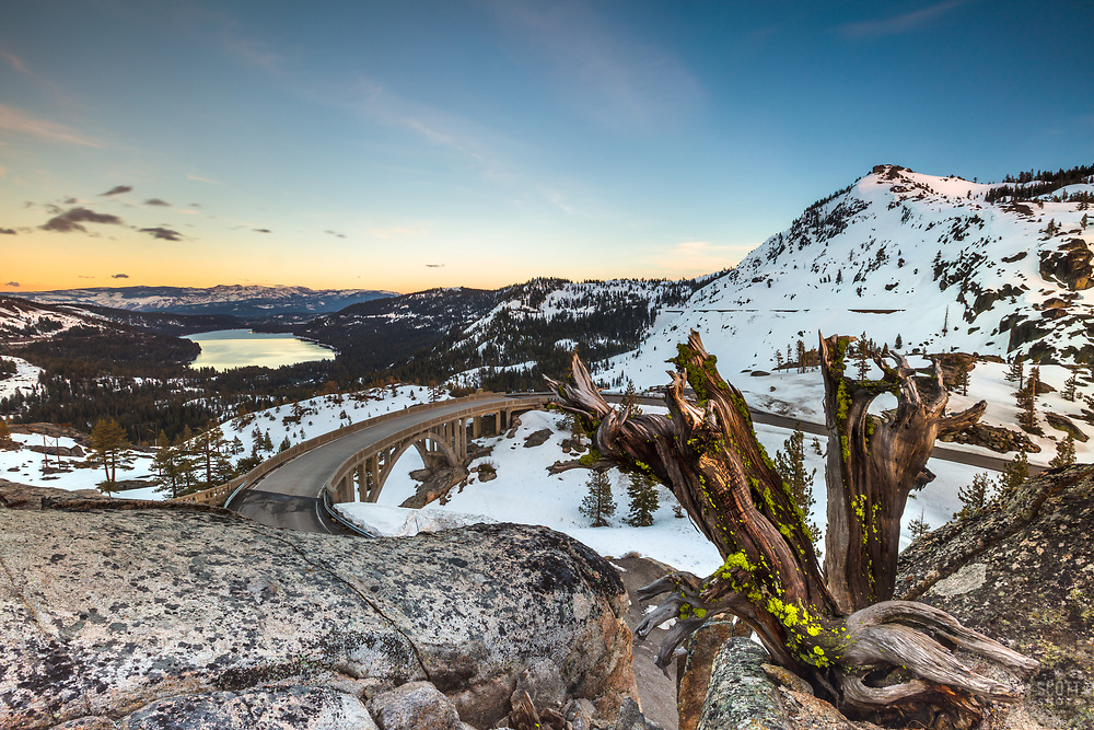 """Sunset at Rainbow Bridge 4"" - Sunset photograph of an old dead tree above Rainbow Bridge and Donner Lake in Truckee, California."