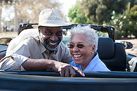 Portrait of senior couple at the back seat of car, smiling