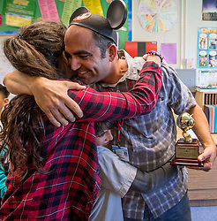May 2, 2017 - Huntington Beach, California, USA - Vincent Saporito gets a hug from his daughter, Marie Saporito, as they squish his son, Francis Saporito, after he was surprised with a 2018 Teacher of the Year award from the Orange County Department of Education in Huntington Beach, California, on Tuesday, May 2, 2017. ..Saporito, is a special education teacher for the deaf and hard of hearing at College View Elementary School, is one of six teachers who were surprised with the honor by county superintendent of school Dr. Al Mija?res. ..(Photo by Jeff Gritchen, Orange County Register/SCNG) (Credit Image: © Jeff Gritchen, Jeff Gritchen/The Orange County Register via ZUMA Wire)