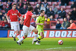 LONDON, ENGLAND - Saturday, January 30, 2010: Charlton Athletic's  Christian Dailly is beaten to the ball by Tranmere Rovers' Chris Shuker run during the Football League One match at the Valley. (Photo by Gareth Davies/Propaganda)