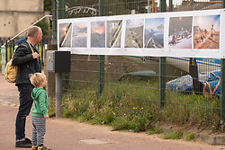 """An outdoor photography exhibition was installed this morning in Portobello, Edinburgh. The exhibition links Portobello with the town of Akureyri in northern Iceland. Fifteen photographers from each place have contributed images on paired themes. The Portobello exhibition is part of this year's Art Walk Porty - a pandemic resticted version of the annnual arts event on the theme """"All at Sea"""". The exhibition is also currently on display in Iceland, in a similar outdoor location. <br /> © Jon Davey/ EEm"""