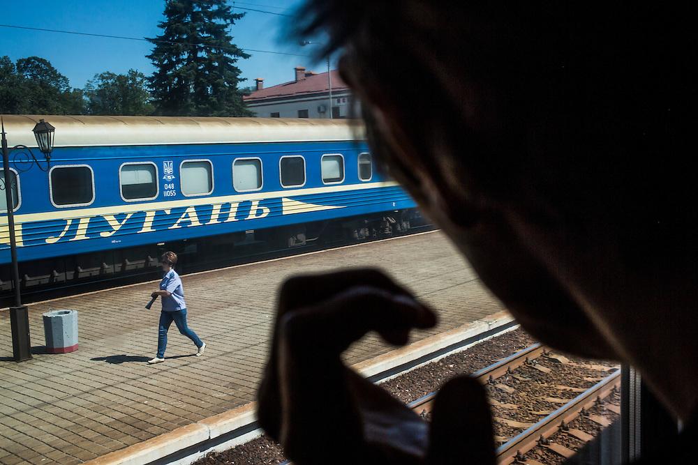 A passenger train arrives in Donetsk on Sunday, July 27, 2014 in Donetsk, Ukraine.