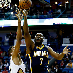 Dec 15, 2016; New Orleans, LA, USA; Indiana Pacers center Al Jefferson (7) shoots over New Orleans Pelicans center Alexis Ajinca (42) during the first quarter of a game at the Smoothie King Center. Mandatory Credit: Derick E. Hingle-USA TODAY Sports