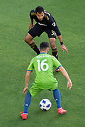 Los Angeles FC defender Steven Beitashour (3) defends against Seattle Sounders midfielder Alex Roldan (16) during a MLS soccer match in the inaugural game at Banc of California Stadium in Los Angeles, Sunday, April 29, 2018. LAFC defeated the Sounders 1-0. (Eddie Ruvalcaba/mage of Sport)