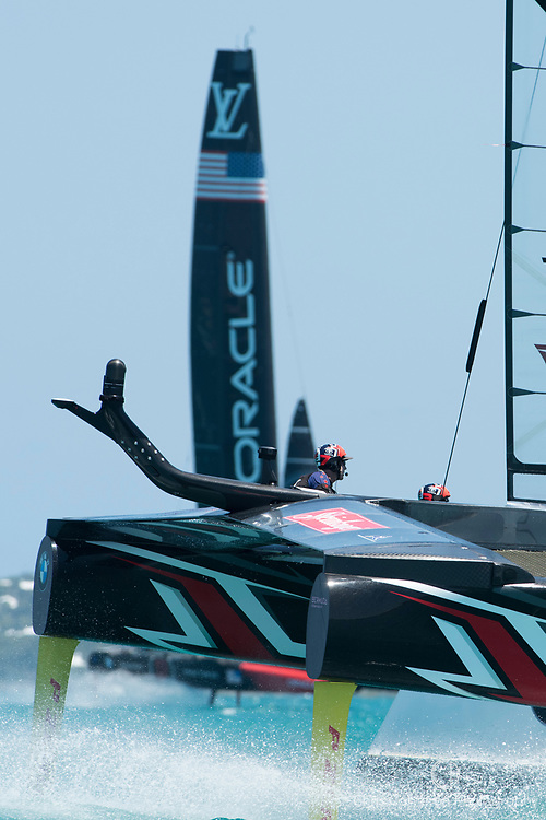 The Great Sound, Bermuda, 18th June. Emirates Team New Zealand round the top mark more than 40 seconds ahead of Oracle Team USA in race three on day two of the America's Cup.