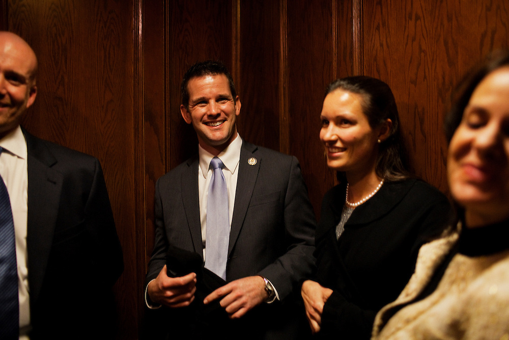 Freshman Congressman Adam Kinzinger, 32, (Republican, Illinois) rides an elevator in The Capital Hill Club with supporters after being sworn in to office at the United States Capital in Washington, DC on Wednesday, January 5, 2011. He will be a member of the 112th Congress, and represents the 11th Congressional District.