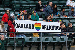 OAKLAND, CA - JUNE 14:  Oakland Athletics fans hold up a sign in remembrance of victims of the Orlando terror attack on Pride Night before the game against the Texas Rangers at the Oakland Coliseum on June 14, 2016 in Oakland, California. (Photo by Jason O. Watson/Getty Images) *** Local Caption ***