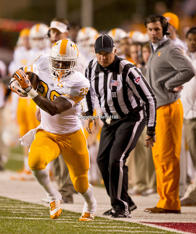 Nov 12, 2011; Fayetteville, AR, USA; Tennessee Volunteers tailback Tauren Poole (28) carries the ball during the first half of a game against the Arkansas Razorbacks at Donald W. Reynolds Razorback Stadium. Arkansas defeated Tennessee 49-7. Mandatory Credit: Beth Hall-US PRESSWIRE