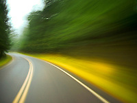 Details are rendered as motion blurs along a curve in the road.