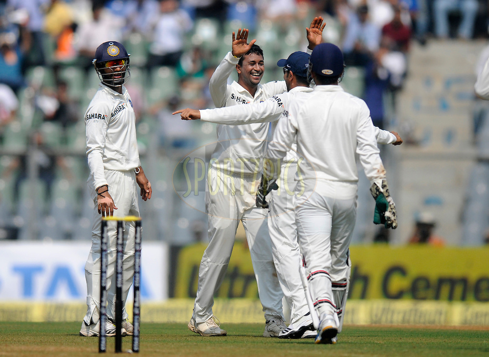 Pragyan Ojha of India celebrates the wicket of Marlon Samuels of West Indies during day one of the second Star Sports test match between India and The West Indies held at The Wankhede Stadium in Mumbai, India on the 14th November 2013<br /> <br /> This test match is the 200th test match for Sachin Tendulkar and his last for India.  After a career spanning more than 24yrs Sachin is retiring from cricket and this test match is his last appearance on the field of play.<br /> <br /> Photo by: Pal PIllai - BCCI - SPORTZPICS<br /> <br /> Use of this image is subject to the terms and conditions as outlined by the BCCI. These terms can be found by following this link:<br /> <br /> http://sportzpics.photoshelter.com/gallery/BCCI-Image-Terms/G0000ahUVIIEBQ84/C0000whs75.ajndY