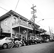 NEW ORLEANS, LA – OCTOBER 28, 2009: A woman rides a bicycle along Frenchmen Street.