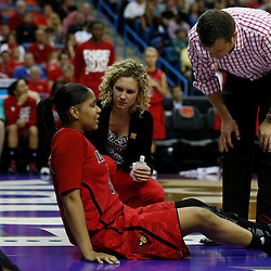 April 7, 2013; New Orleans, LA, USA; Louisville Cardinals forward Monique Reid (33) reacts after an injury as head coach Jeff Walz (right) looks on during the first half in the semifinals during the 2013 NCAA womens Final Four against the California Golden Bears at the New Orleans Arena. Mandatory Credit: Derick E. Hingle-USA TODAY Sports