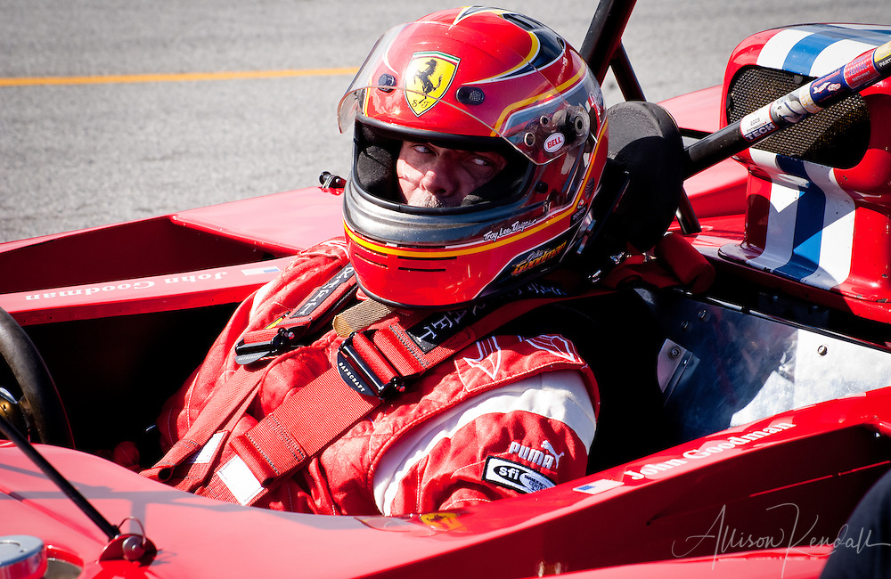Close-up of Ferrari driver during pit-stop, Laguna Seca during the Reunion events of Monterey Car Week