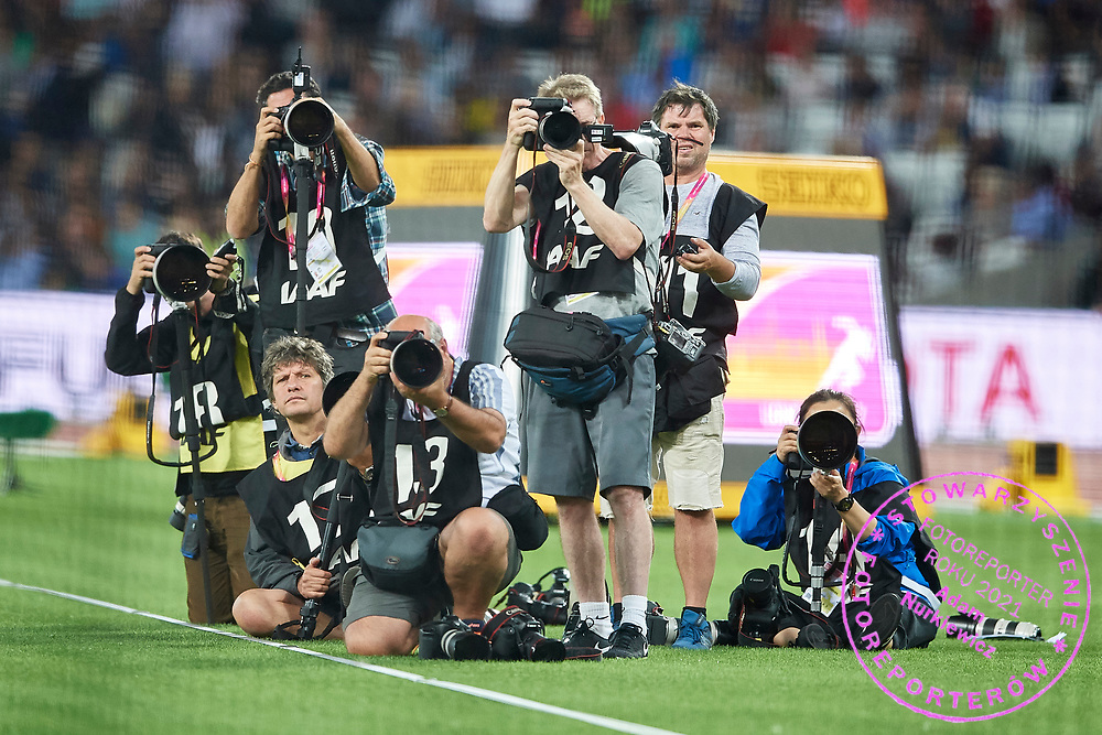Great Britain, London - 2017 August 11: Photographers (L) Radoslaw Joziwak (cyfrasport Agency) and Diego Azubel (European Press Agency) and sits Kuba Wojciech Atys (Gazeta Wyborcza Daily) and knees freelancer Jean Pierre Durand work during IAAF World Championships London 2017 Day 8 at London Stadium on August 11, 2017 in London, Great Britain.<br /> <br /> Mandatory credit:<br /> Photo by &copy; Adam Nurkiewicz<br /> <br /> Adam Nurkiewicz declares that he has no rights to the image of people at the photographs of his authorship.<br /> <br /> Picture also available in RAW (NEF) or TIFF format on special request.<br /> <br /> Any editorial, commercial or promotional use requires written permission from the author of image.