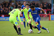 AFC Wimbledon striker Andy Barcham (17) taking on Peterborough United defender Michael Smith (2) during the EFL Sky Bet League 1 match between AFC Wimbledon and Peterborough United at the Cherry Red Records Stadium, Kingston, England on 17 April 2017. Photo by Matthew Redman.