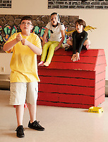 Charlie Brown (Charles Purcell) with Snoopy (Cyndal VanSteensburg) and Woodstock (Ty Colby) during Gilford Middle School's dress rehearsal for Pops Night to be held at the Gilford Middle School Cafe on Friday and Saturday evening at 7pm.  (Karen Bobotas/for the Laconia Daily Sun)