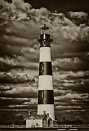 black/white landscape of Bodie Lighthouse with billowing clouds in Outer Banks, North Carolina
