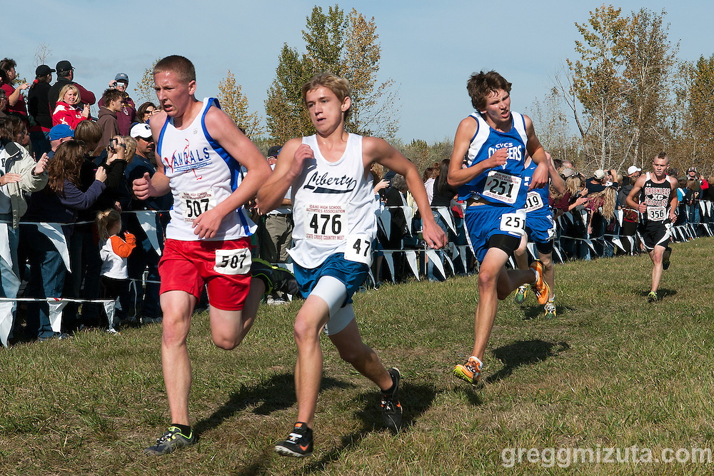 Fight to the finish (L to R: Clint Thomas, Gabe Housh, and Jacob Bottles) during the Idaho High School State Cross Country Championships 2A boys race at Eagle Island State Park on October 29, 2011.