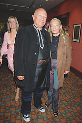 Actor STEVEN BERKOFF and CLARA FISCHER at a private view of work by Sacha Newley entitled 'Blessed Curse' in association with the Catto Gallery held at the Arts Club, Dover Street, London W1 on 2nd July 2008.<br />