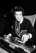 Alex Baby cues up a record, Subterrania club,  London, 1990s.