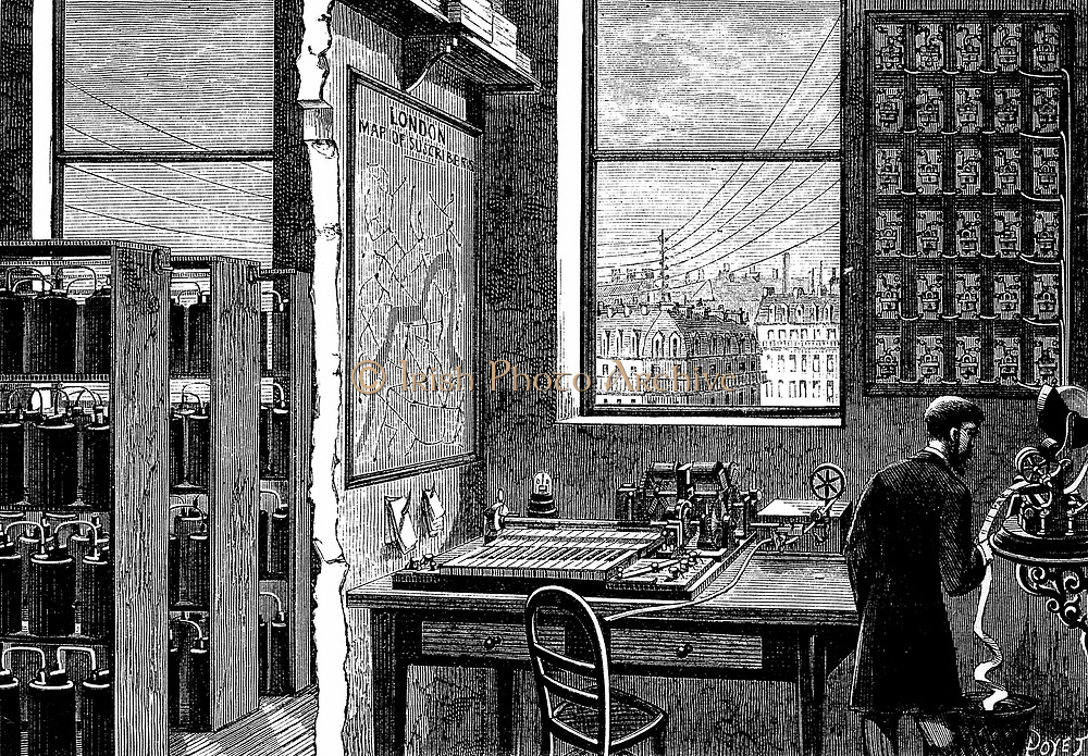 Main station of Exchange Telegraph Company, London, England,showing operator receiving a message on ticker-tape machine. Morse transmitting instrument connected directly to the Stock Exchange. Left: bichromate cells providing electricity. 'La Nature' Paris 1882.