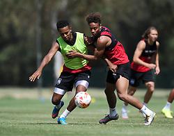 Bobby Reid of Bristol City battles for the ball with Korey Smith of Bristol City  - Photo mandatory by-line: Joe Meredith/JMP - Mobile: 07966 386802 - 16/07/2015 - SPORT - Football - Albufeira -  - Pre-Season Training