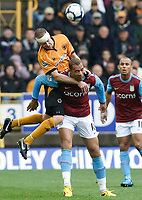 Photo: Steve Bond/Richard Lane Photography. Wolverhampton Wanderers v Aston Villa. Barclays Premiership 2009/10. 24/10/2009. Jody Craddock (upper) and John Carew battle in the air