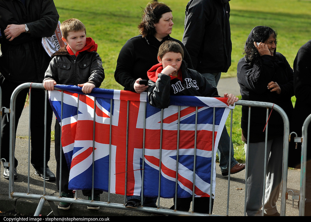 © Licensed to London News Pictures. 21/02/2012, Oxford, UK. Two boys wait for the princess. The Duchess of Cambridge Kate Middleton leaves Rose Hill Primary School in Oxford today 21 February 2012. Photo credit : Stephen Simpson/LNP