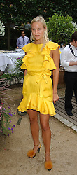 OLYMPIA SCARRY at the Tatler Summer Party in association with Moschino at Home House, 20 Portman Square, London W1 on 29th June 2005.<br />