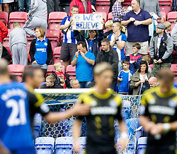 """WIGAN, ENGLAND - Sunday, August 19, 2012: Wigan Athletic's supporters with a """"We Believe"""" sign in the stands after the Premiership match against Chelsea at the DW Stadium. (Pic by Vegard Grott/Propaganda)"""