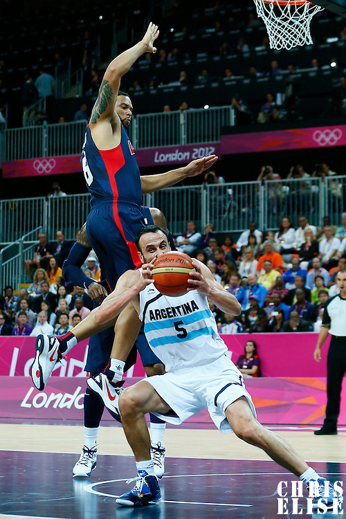 06 August 2012: Argentina Manu Ginobili is seen under the basket as Deron Williams jumps during 126-97 Team USA victory over Team Argentina, during the men's basketball preliminary, at the Basketball Arena, in London, Great Britain.