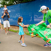 August 21, 2016, New Haven, Connecticut: <br /> Fans receive give away Shop Rite kids gift bags during Day 3 of the 2016 Connecticut Open at the Yale University Tennis Center on Sunday, August  21, 2016 in New Haven, Connecticut. <br /> (Photo by Billie Weiss/Connecticut Open)
