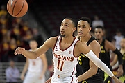 Feb 15, 2018; Los Angeles, CA, USA;Southern California Trojans guard Jordan McLaughlin (11) and Oregon Ducks guard Elijah Brown (5) battle for the ball in the first half during an NCAA basketball game at Galen Center.