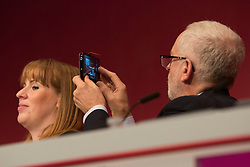 26/09/2017. Brighton, UK. Leader of the Labour Party JEREMY CORBYN takes a photo of Shadow Secretary of State for Business, Energy and Industrial Strategy and Salford and Eccles MP REBECCA LONG BAILEY as she speaks on the third day of the 2017 Labour Party Conference in Brighton. Photo credit: Hugo Michiels/LNP