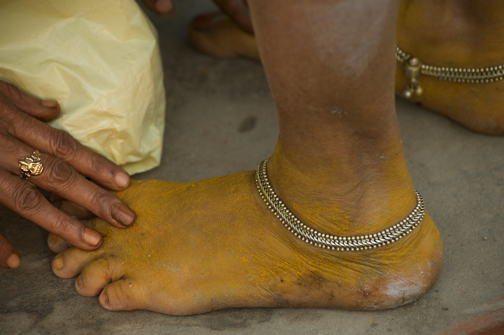 People touch the feet of elders to show respect and in return receive a blessing