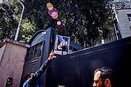 Roma 18 Giugno 2015<br /> Manifestazione degli Animalisti Italiani,  vicino all'ambasciata della Cina, per protestare  contro il  Festival di Yulin che si terrà il 21 giugno. Yulin è una metropoli cinese di 5 milioni e mezzo di abitanti, dove il 21 giugno di ogni anno, per il solstizio d'estate, si celebra un Festival per il quale vengono macellati e poi mangiati circa 10mila cani. Animalista lancia una foto di un cane ucciso durante la festa di Yulin, all'interno dell'ambasciata della Cina.<br /> Rome June 18, 2015<br /> Animal rights activists demonstrated, near the Embassy of China, to protest against the Festival of Yulin to be held on June 21. Yulin is a Chinese metropolis of 5 million and a half inhabitants, where on June 21 of each year, for the summer solstice, is celebrated a festival for which are then slaughtered and eaten about 10 thousand dogs. Animal rights activist casts a picture of a dog killed during the feast of Yulin, inside the embassy of China.