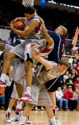 February 27, 2010; Stanford, CA, USA;  Stanford Cardinal guard/forward Landry Fields (2) grabs a rebound over teammate Stanford Cardinal forward Andrew Zimmermann (34) and Arizona Wildcats center Kyryl Natyazhko (1) during the first half at Maples Pavilion.  Arizona defeated Stanford 71-69.