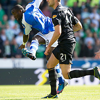 St Johnstone v Celtic....15.09.12      SPL  <br /> Gregory Tade scores for saints<br /> Picture by Graeme Hart.<br /> Copyright Perthshire Picture Agency<br /> Tel: 01738 623350  Mobile: 07990 594431